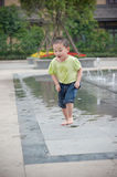 Cute Asian Boy In Park Stock Image