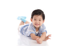 Cute asian boy lying on white background Royalty Free Stock Photos