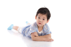 Cute asian boy lying on white background Stock Photography
