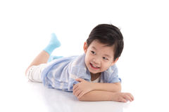 Cute asian boy lying on white background Stock Images