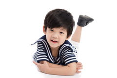 Cute asian boy lying on white background isolated Royalty Free Stock Photos