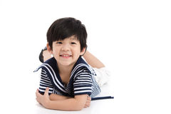 Cute asian boy lying on white background isolated Stock Image