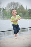 Cute asian boy in park Stock Photo