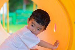 Free Cute Asian Boy Playing And Smiling In Yellow Tunnel At The Playg Royalty Free Stock Photography - 100928277