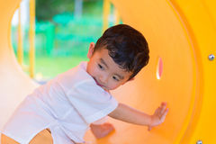 Free Cute Asian Boy Playing And Smiling In Yellow Tunnel At The Playg Royalty Free Stock Images - 99082629