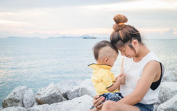 Cute asian boy playing with his mother Royalty Free Stock Photo