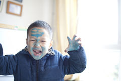 Cute asian boy playing painting at home Stock Images