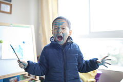 Cute asian boy playing painting at home Royalty Free Stock Photos