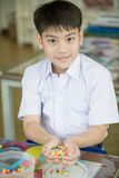 Cute asian boy playing with plastic blocks in class room at scho Stock Image