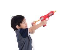 Cute asian boy playing toy gun Stock Photography