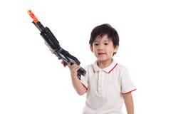 Cute asian boy playing toy gun Royalty Free Stock Photo