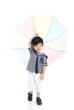 Cute asian boy in sailor uniform holding umbrella Royalty Free Stock Images