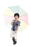 Cute asian boy in sailor uniform holding umbrella Stock Photos