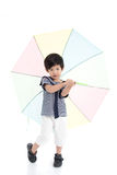 Cute asian boy in sailor uniform holding umbrella Stock Image