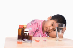 Cute asian boy sick with medicine. On white background royalty free stock photography