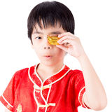 Cute Asian Boy In Tradition Chinese Cheongsam Royalty Free Stock Image