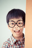Cute asian boy wear glasses (retro filter) Stock Photography