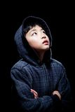 Cute Asian boy wearing hooded sweatshirt Stock Images