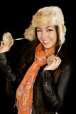 Cute Asian Caucasian girl pulling fur hat strings smiling Stock Photography