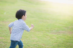 Cute Asian chid running Royalty Free Stock Image