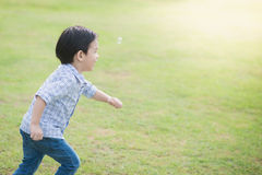Cute Asian chid running Royalty Free Stock Photography