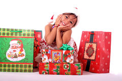 Cute asian child with christmas gifts Royalty Free Stock Image