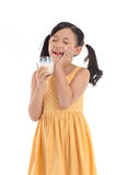 Cute asian child drinking milk Stock Images