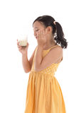 Cute asian child drinking milk Royalty Free Stock Image