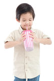 Cute Asian child drinking with paper straw stock photos