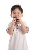 Cute asian child eating rice ball or onigiri Royalty Free Stock Images