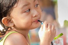 Cute Asian Child Thirsty Drinking Iced Lemonade Royalty Free Stock Photography