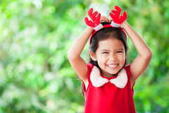 Cute asian child girl in christmas dress smiling Royalty Free Stock Image