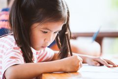 Cute asian child girl drawing and painting with crayon. With fun royalty free stock images