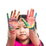 Cute asian child girl with hands painted in colorful paint Royalty Free Stock Photo