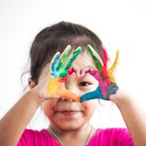 Cute asian child girl with hands painted make heart shape. On white background royalty free stock photography