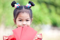 Cute asian child girl holding red envelope royalty free stock photos