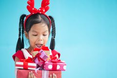 Cute asian child girl surprise with gift stock photos