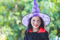 Asian child girl wearing halloween costumes and makeup having fun on Halloween celebration