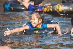 Asian  child girls playing water with inflatable ring in the river in summer time with fun and happiness. Cute asian  child girls playing water with inflatable royalty free stock photos