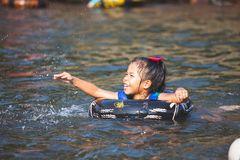 Asian child girls playing water with inflatable ring in the river in summer time with fun and happiness. Cute asian  child girls playing water with inflatable royalty free stock image