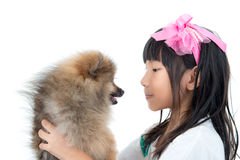 Cute Asian child with her happy doggy. On white background Stock Image