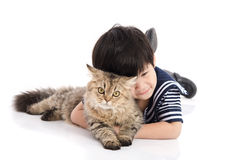 Cute asian child lying with tabby cat Royalty Free Stock Image
