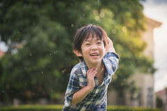 Cute Asian child playing pilot aviator in the park stock image