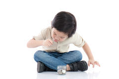 Cute Asian child saving money in glass bottle Royalty Free Stock Photography
