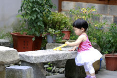 Cute Asian Chinese baby girl play in a garden Royalty Free Stock Photos