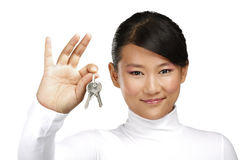 Cute asian chinese girl showing flat keys Royalty Free Stock Image