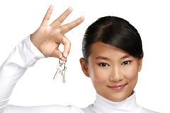 Cute asian chinese girl showing flat keys Royalty Free Stock Photo