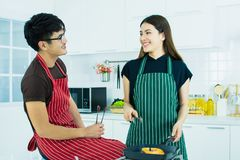 A couple is cooking in the kitchen royalty free stock image