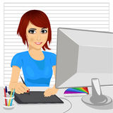 Cute asian female designer in office working with digital graphic tablet and digital pen Stock Images