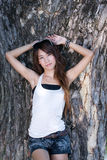 Cute asian girl. A portrait of asian girl in front of tree Stock Image